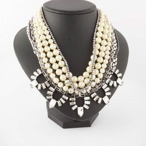 STARLET PEARL NECKLACE  A mix of hand-strung glass pearls and chic sparkle strands create our most...