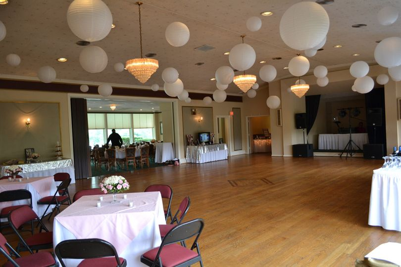 The dance floor of this fun, yet classic, Beauty and the Beast themed wedding reception.
