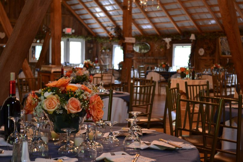 A view of the reception tables for this rustic elegance themed wedding reception