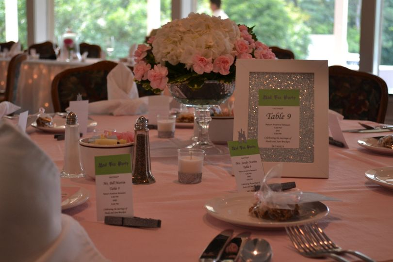 Cassandra Poling Events created the custom table numbers and escort cards for this classic wedding...