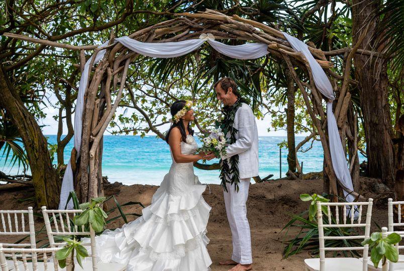 Bride and groom under the Castaway Wedding Cabana