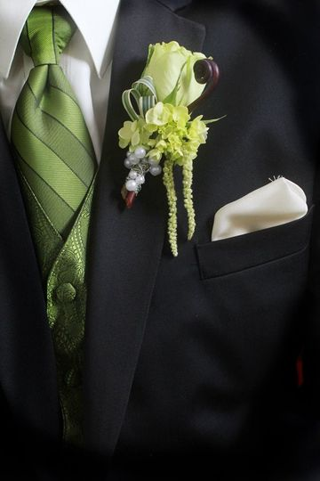Super green rose, fiddleheads, hanging amarynthus wrapped with pearl wire. Boutonniere