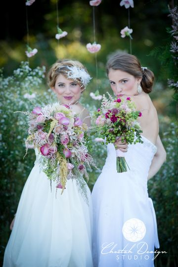 Two gorgeous ladies with two beautiful bouquets.