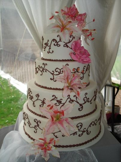 Hand-made and hand-painted sugar star gazer lilies add a special touch to this four-tiered fondant...