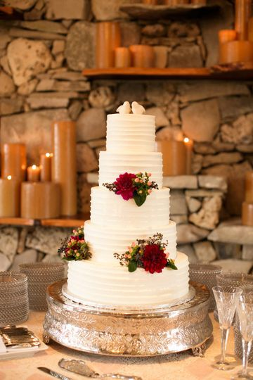 White wedding cake with red roses