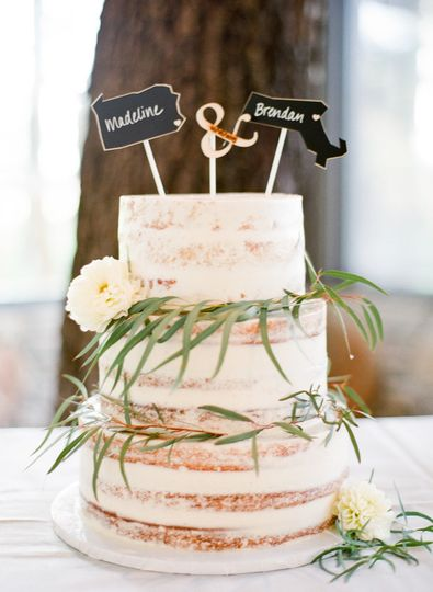 Simple wedding cake with grass and flowers
