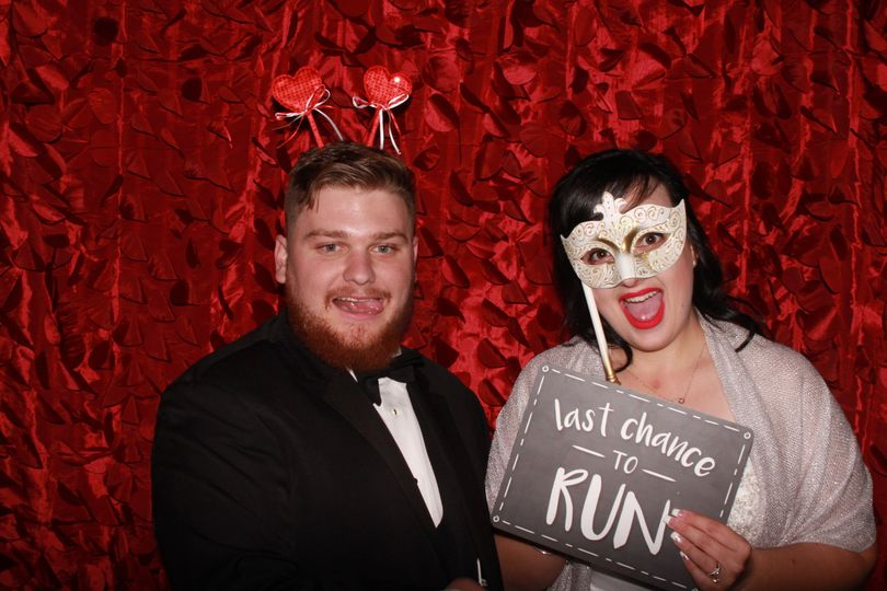 Bride and groom enjoying photo booth