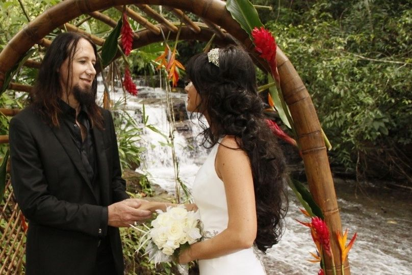 Waterfall Wedding bamboo arch and flowers