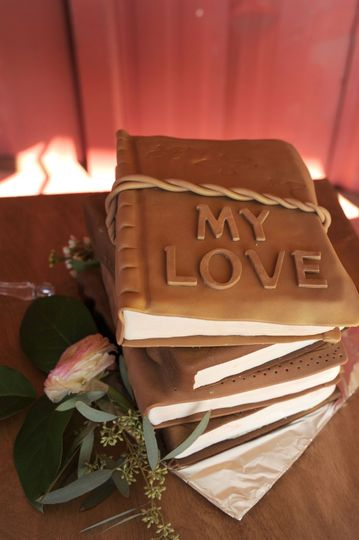 Stack of books grooms cake