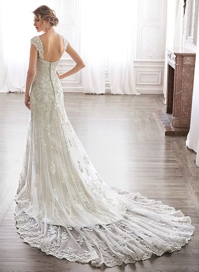 With an eye to timeless romance, this slim A-line design features a delicate, sweetheart neckline...