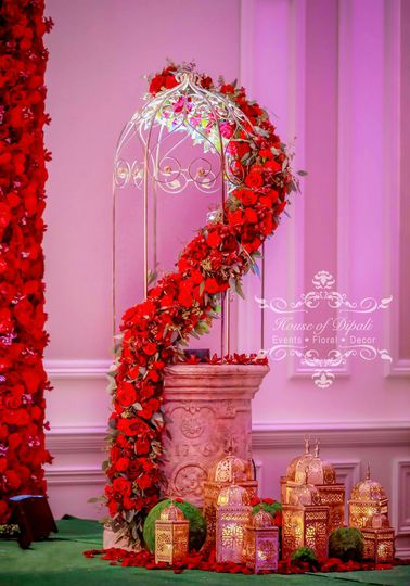 Antique lanterns decorated with wild red roses