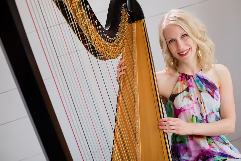 Harpist in a colorful dress