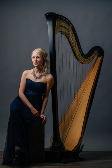 With her harp