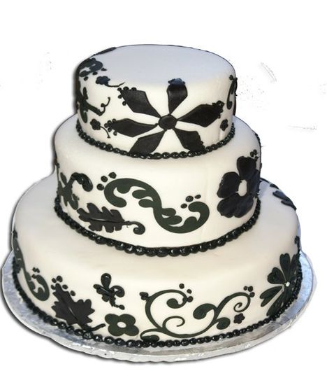 This 3 tiered round cake is iced in my butter cream icing topped with my home made rolled fondant...