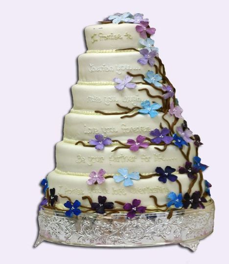 This 6 tiered round cake is iced in my butter cream, topped with my home made rolled fondant, and is...