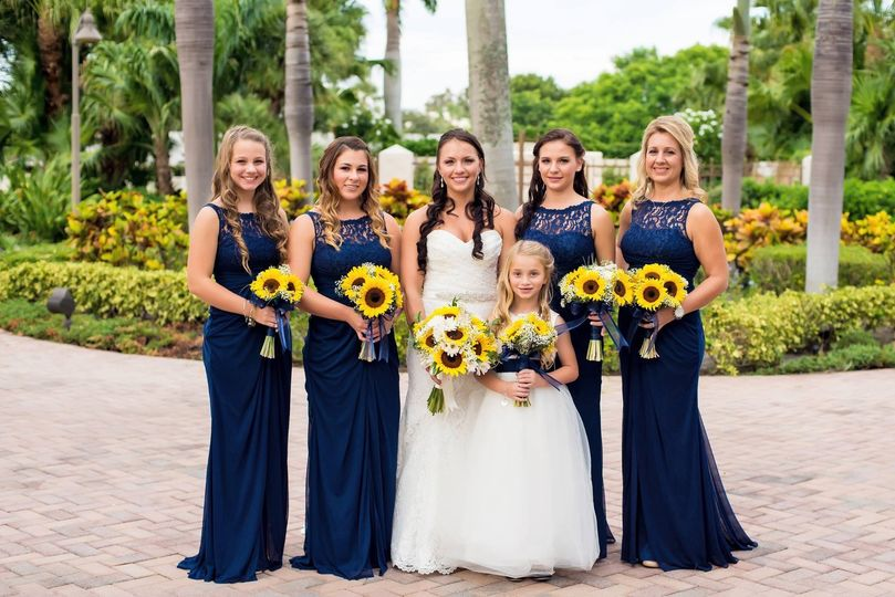 The bride with friends holding bouquets