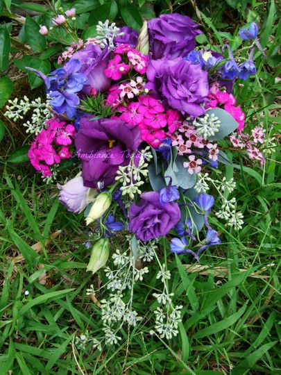 Lisianthus, sweet williams, wax flower, seeded eucalyptus, delphinium  make up this wild, loose,...