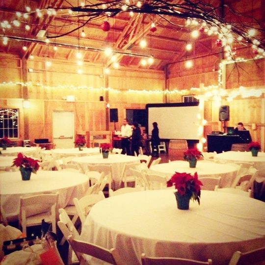 Floral centerpieces and barn lighting