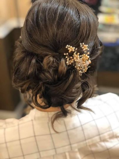 Loose bun with decorative piece