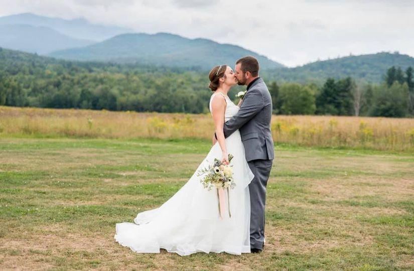 Couple kisses before the landscape