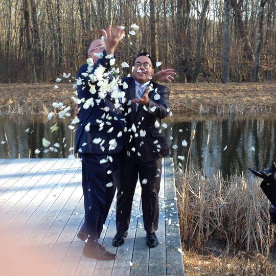 Grooms tossing petals