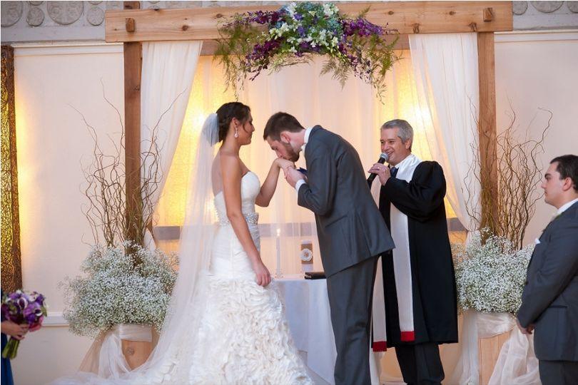 Groom kisses his bride's hand