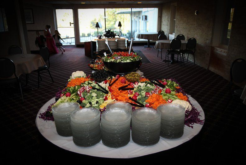 The starting of a traditional buffet line.
