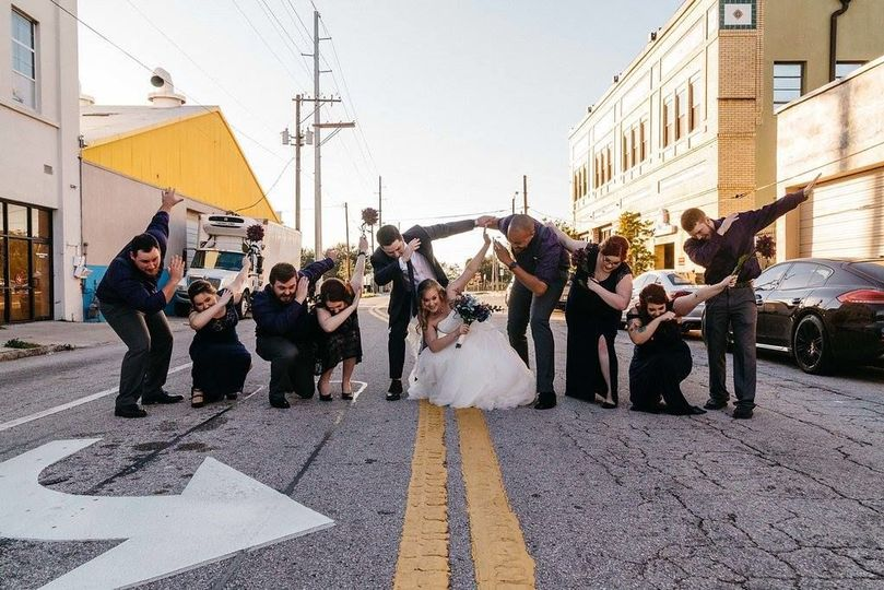 Newlyweds and their guests dabbing