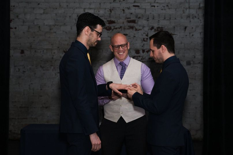 Putting the ring on his groom