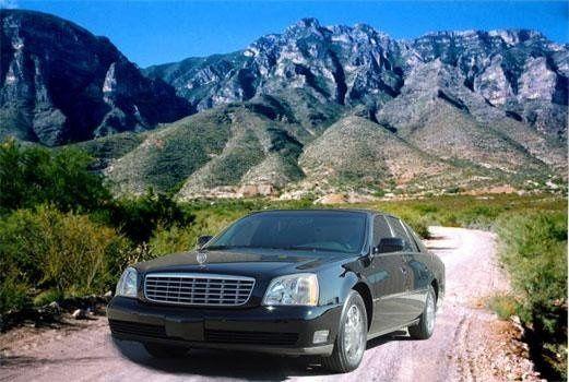 4 passenger black Cadillac Deville