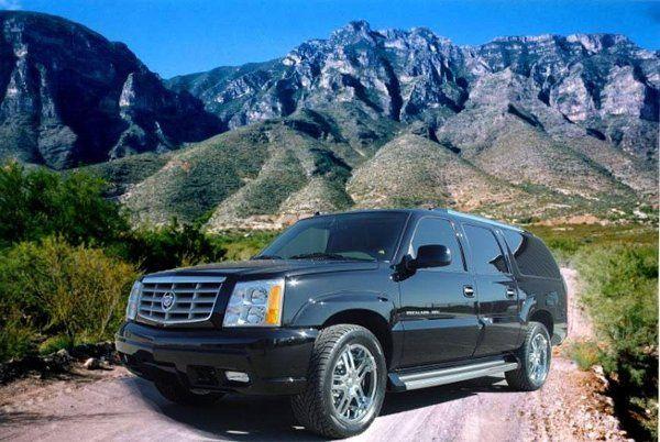 5-passenger black Cadillac Escalade
