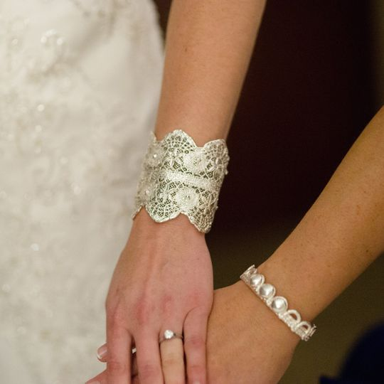 Megan is wearing a bridal lace cuff made from her grandmother's wedding dress lace from 1945....