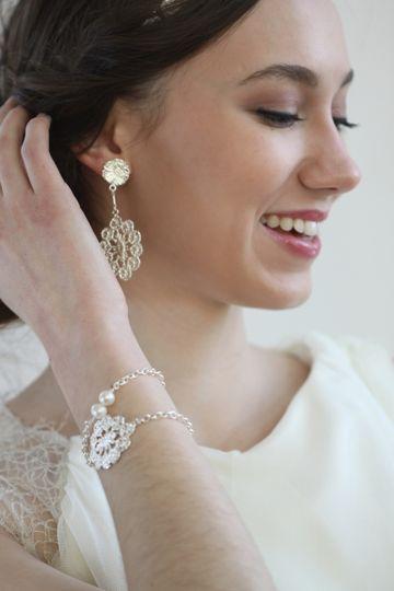 rita earrings and rosetta bracelet on model