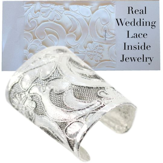 This beautiful silver wedding cuff is made from the brides wedding dress lace sample.