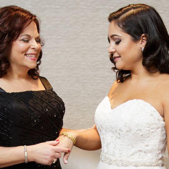 mother handing tamara the bracelet