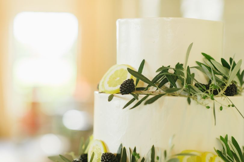 Smoothly iced with greenery, lemon slices, and fresh berries