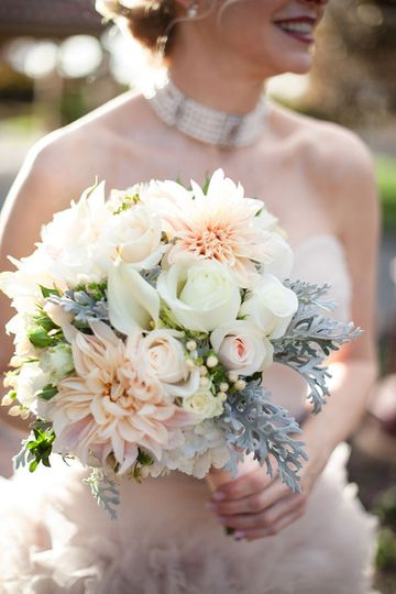 Bride enjoying her flowers on her Wedding Day presented by New York Wedding Videography by Belinda...