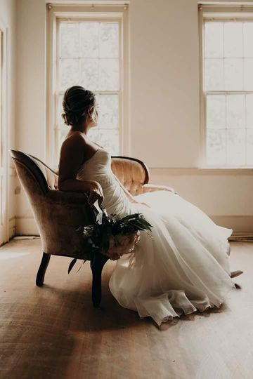 Bride resting on loveseat