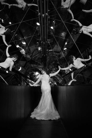 Bride posing with intricate mirror backdrop