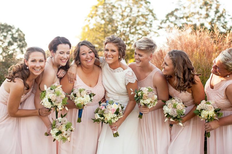 Smiling wedding party