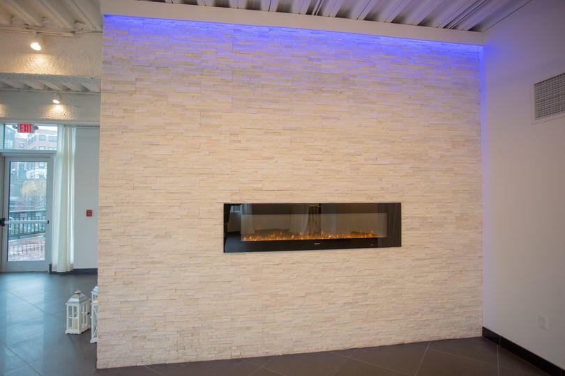 White stone wall fireplace