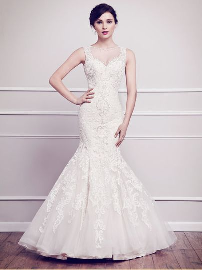 Style 1565  is a Fit and Flare silhouette gown covered in soft cotton lace from the bateau neckline...