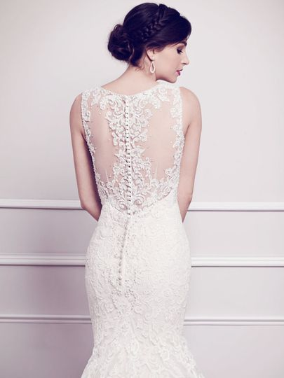 Kenneth Winston Style #1565 The back consists of a sheer illusion detailed with cotton lace,...