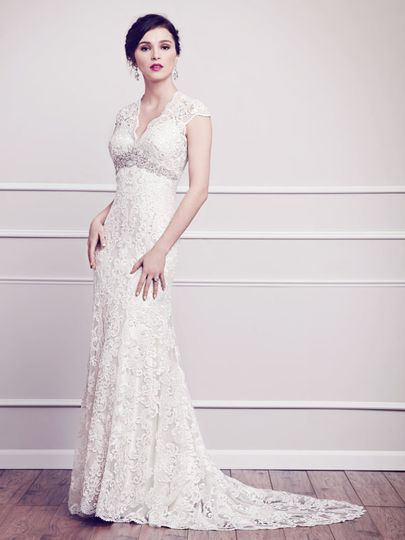 Kenneth Winston 1584- Classic V-neckline gown wrapped with floral arrangements made of Venice Lace...