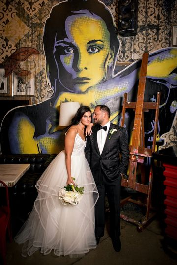 Couple's portrait before the mural