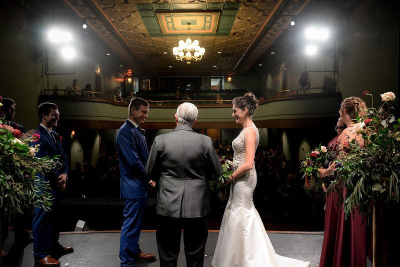 Wedding ceremony in the Historic Theatre of the Pella Opera House | Photo by: Digital Galleria...