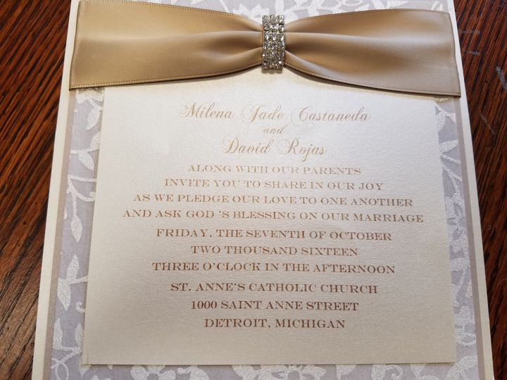 Square flat invite with handmade papers and lovely satin ribbon and buckle.  Classic beauty.
