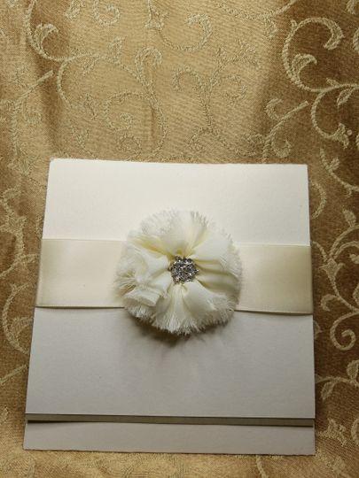 Ivory shimmer bi-fold with beautiful fringed chiffon bow and ivory silk ribbon