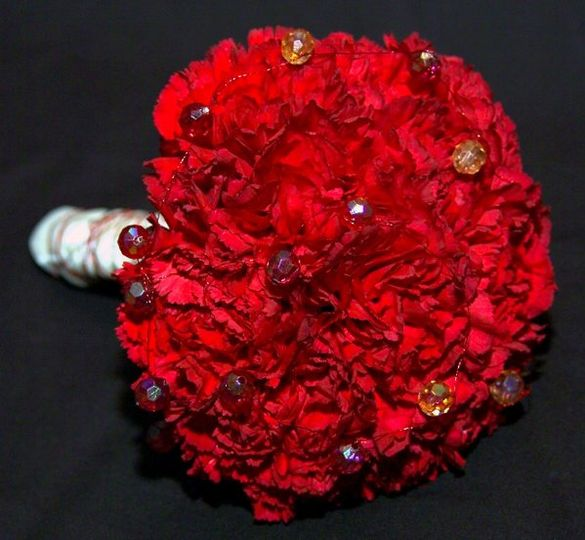 Red carnations with wire and bead accents.