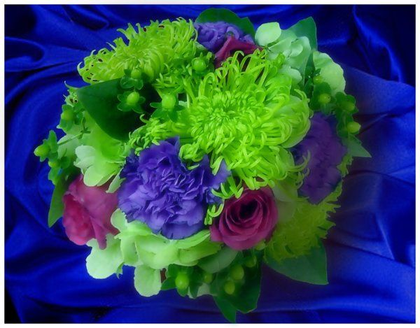 Bright bouquet of fuji mums, hydrangea, roses, carnations, and berries.
